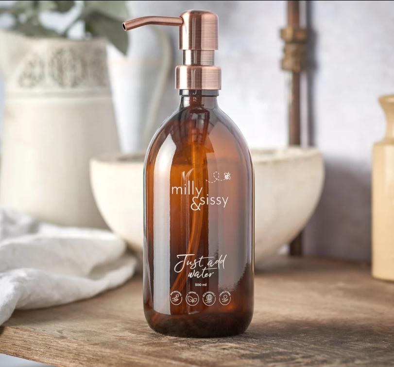 Britische Glasflasche mit bronzierter Pumpe